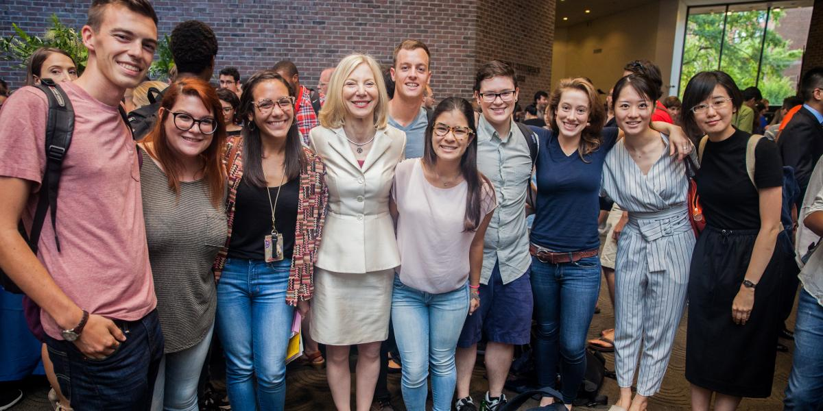 Amy Gutmann with students