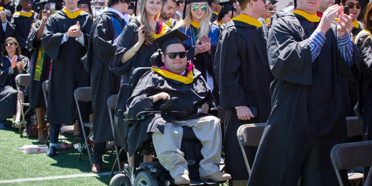 graduate at ceremony using wheelchair