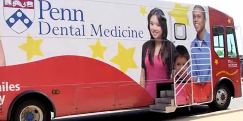 Penn Smiles bus on the street