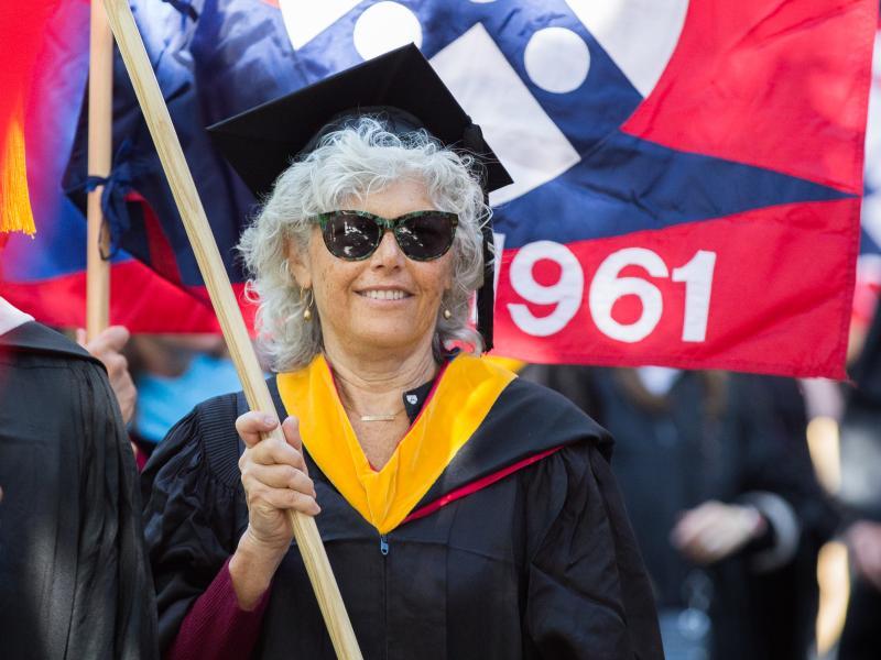 Female flag bearer at commencement