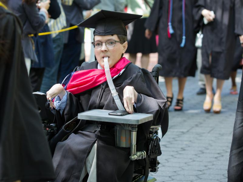 Graduate in procession using wheelchair